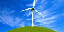 A wind turbine on some grass